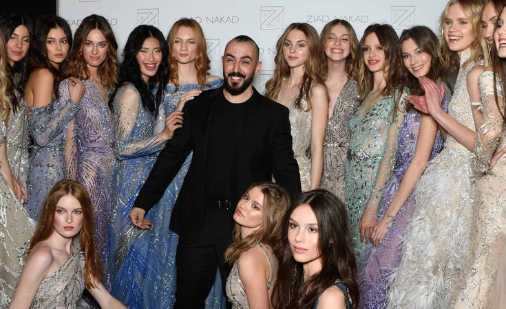 PARIS, FRANCE - JANUARY 24: Designer Ziad Nakad poses with models backstage after the Ziad Nakad Spring Summer 2018 show as part of Paris Fashion Week on January 24, 2018 in Paris, France. (Photo by Jonathan Philippe Levy/Getty Images For Ziad Nakad) *** Local Caption *** Ziad Nakad